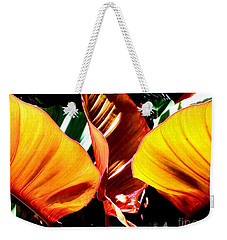Weekender Tote Bag featuring the photograph Flaming Plant by Kristine Merc