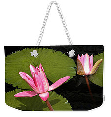 Weekender Tote Bag featuring the photograph Floating by Jean Goodwin Brooks