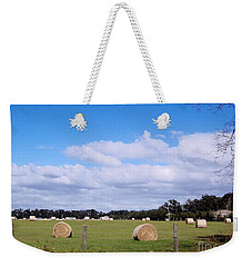 Weekender Tote Bag featuring the photograph Florida Hay Rolls by D Hackett