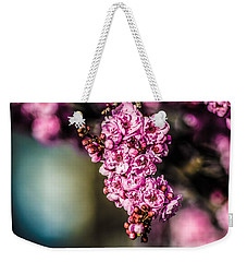 Weekender Tote Bag featuring the photograph Flourishing In Pink by Naomi Burgess