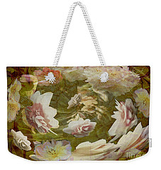 Weekender Tote Bag featuring the photograph Flower Drift by Nareeta Martin