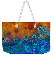 Weekender Tote Bag featuring the photograph Flower Fantasy In Blue And Orange  by Ann Powell