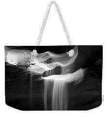 Weekender Tote Bag featuring the photograph Flowing Sand In Antelope Canyon by Lucinda Walter