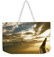 Weekender Tote Bag featuring the photograph Flying Clouds By David Pucciarelli by Iconic Images Art Gallery David Pucciarelli