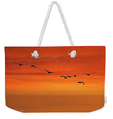 Weekender Tote Bag featuring the photograph Flying South  by Cindy Greenstein