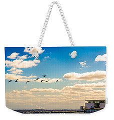 Weekender Tote Bag featuring the photograph Flying To Discovery by Steven Santamour