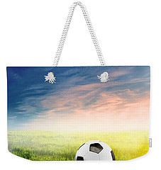 Football Soccer Ball On Green Grass Weekender Tote Bag