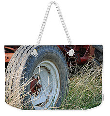Weekender Tote Bag featuring the photograph Ford Tractor Tire by Jennifer Ancker