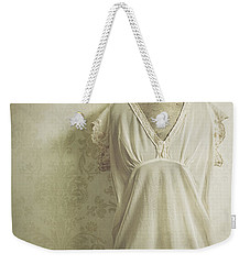 Weekender Tote Bag featuring the photograph Forgotten Beauty by Amy Weiss