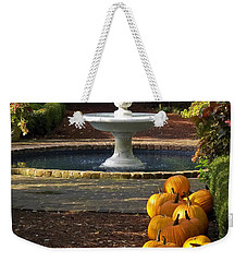 Weekender Tote Bag featuring the photograph Fountain And Pumpkins At The Elizabethan Gardens by Greg Reed