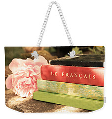 Weekender Tote Bag featuring the photograph French Books And Peony by Brooke T Ryan