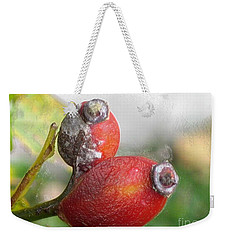 Weekender Tote Bag featuring the photograph Frosted Rosehips by Nina Silver
