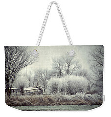 Weekender Tote Bag featuring the photograph Frozen World by Annie Snel