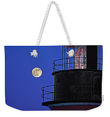 Weekender Tote Bag featuring the photograph Full Moon And West Quoddy Head Lighthouse Beacon by Marty Saccone