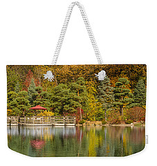 Weekender Tote Bag featuring the photograph Garden Of Reflection by Sebastian Musial