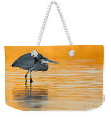 Weekender Tote Bag featuring the photograph Gbh In Orange Water by Bryan Keil