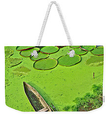 Giant Water Lilies And A Dugout Canoe In Amazon Jungle-peru Weekender Tote Bag by Ruth Hager