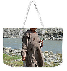 Weekender Tote Bag featuring the photograph Girl Poses For Camera  by Imran Ahmed