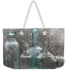 Weekender Tote Bag featuring the photograph Glass Bottles 1 by Jocelyn Friis