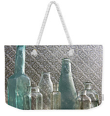 Weekender Tote Bag featuring the photograph Glass Bottles 2 by Jocelyn Friis