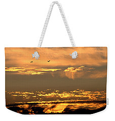Weekender Tote Bag featuring the photograph Golden Clouds by AJ  Schibig