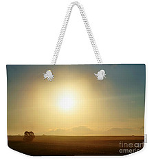 Weekender Tote Bag featuring the photograph Golden Sunset by Judy Palkimas