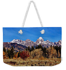 Weekender Tote Bag featuring the photograph Grand Teton Panorama by Benjamin Yeager