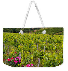 Weekender Tote Bag featuring the photograph Grapes And Roses by Allen Sheffield