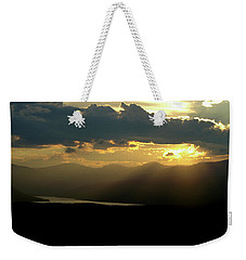 Weekender Tote Bag featuring the photograph Great Divide Light by Jeremy Rhoades