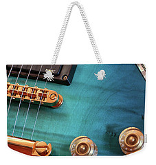 Weekender Tote Bag featuring the photograph Guitar Blues by Joy Watson