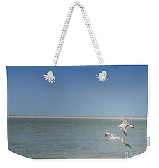 Weekender Tote Bag featuring the photograph Gulls In Flight by Erika Weber