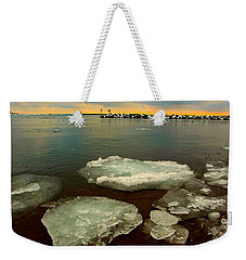 Weekender Tote Bag featuring the photograph Hanging On by Amanda Stadther