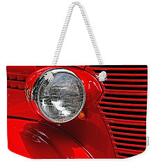 Weekender Tote Bag featuring the photograph Headlight On Red Car by Ludwig Keck