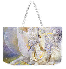 Weekender Tote Bag featuring the mixed media Heart Of A Unicorn by Carol Cavalaris