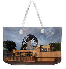 Weekender Tote Bag featuring the photograph He's Got The Whole World In His Hands by Kay Novy
