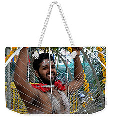 Weekender Tote Bag featuring the photograph Hindu Thaipusam Festival Pierced Devotee  by Imran Ahmed