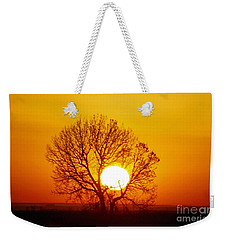Weekender Tote Bag featuring the photograph Holding The Sun by Steven Reed