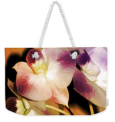 Weekender Tote Bag featuring the photograph Hot Orchid Nights by Holly Kempe
