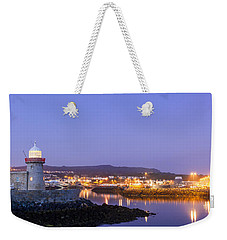 Howth Harbour Lighthouse Weekender Tote Bag by Semmick Photo