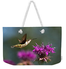 Weekender Tote Bag featuring the photograph Hummingbird Moving Along by Christina Rollo