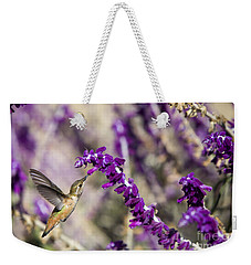 Weekender Tote Bag featuring the photograph Hummingbird Collecting Nectar by David Millenheft