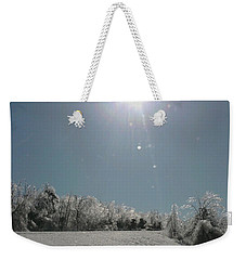 Weekender Tote Bag featuring the photograph Ice Kissed by Ellen Levinson