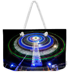 In A Spin Weekender Tote Bag by Ray Warren