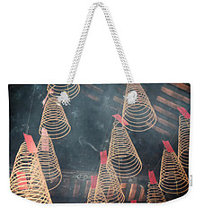 Weekender Tote Bag featuring the photograph Incense Coils by Lucinda Walter