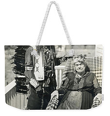 Weekender Tote Bag featuring the photograph Indian Chief And Woman by Charles Beeler