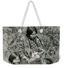 Weekender Tote Bag featuring the photograph Indian Mother With Daughters by Charles Beeler