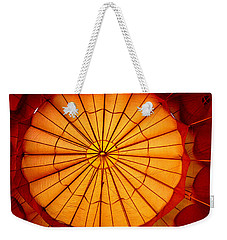 Weekender Tote Bag featuring the photograph Inside The Red Baloon by Nadalyn Larsen