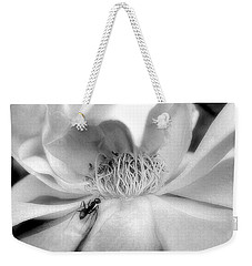 Weekender Tote Bag featuring the photograph Intrigue Rose In Black And White by Louise Kumpf