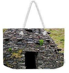 Weekender Tote Bag featuring the photograph Irish Beehive House by Patricia Griffin Brett