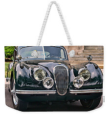 Weekender Tote Bag featuring the photograph Jaguar by Victor Montgomery